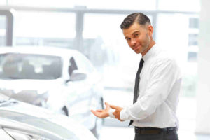 Car Salesman Offering Car